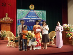 "The conference praised the &quotExcellent and Typical Family"" of Hanoi..."